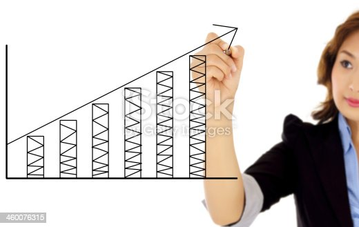 istock businesswoman drawing graph 460076315