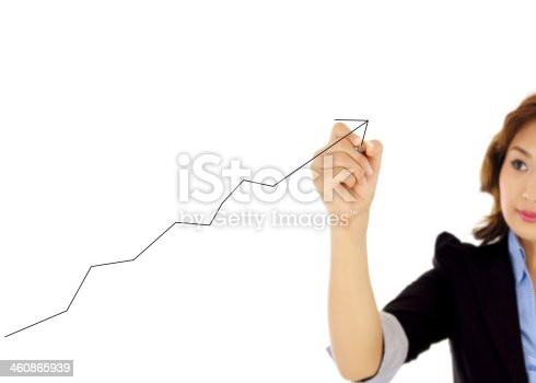 istock businesswoman drawing graph 460865939