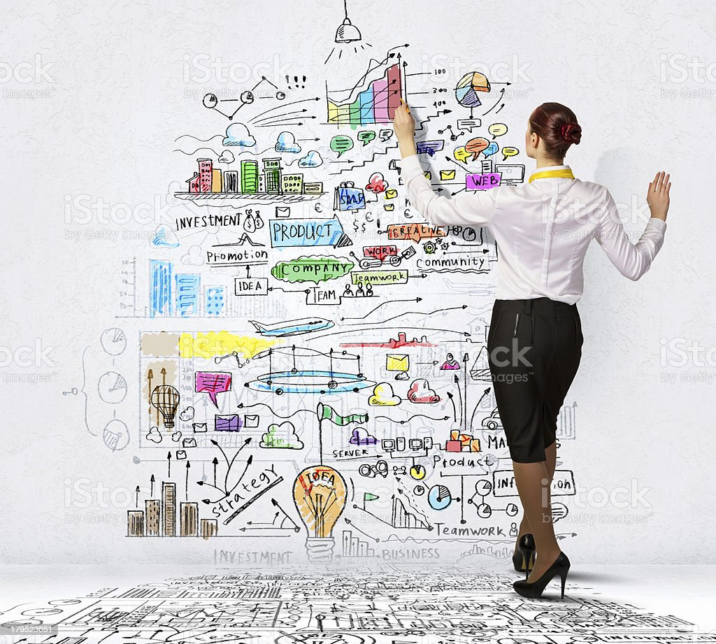Businesswoman drawing on wall stock photo
