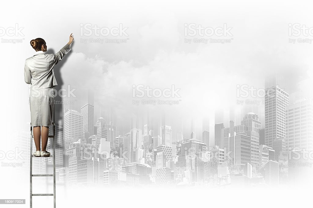 Businesswoman drawing on wall royalty-free stock photo