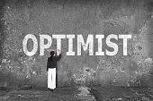 istock businesswoman drawing optimist on the wall 527877409