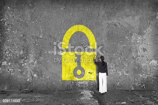 istock businesswoman drawing padlock on the wall 526174533