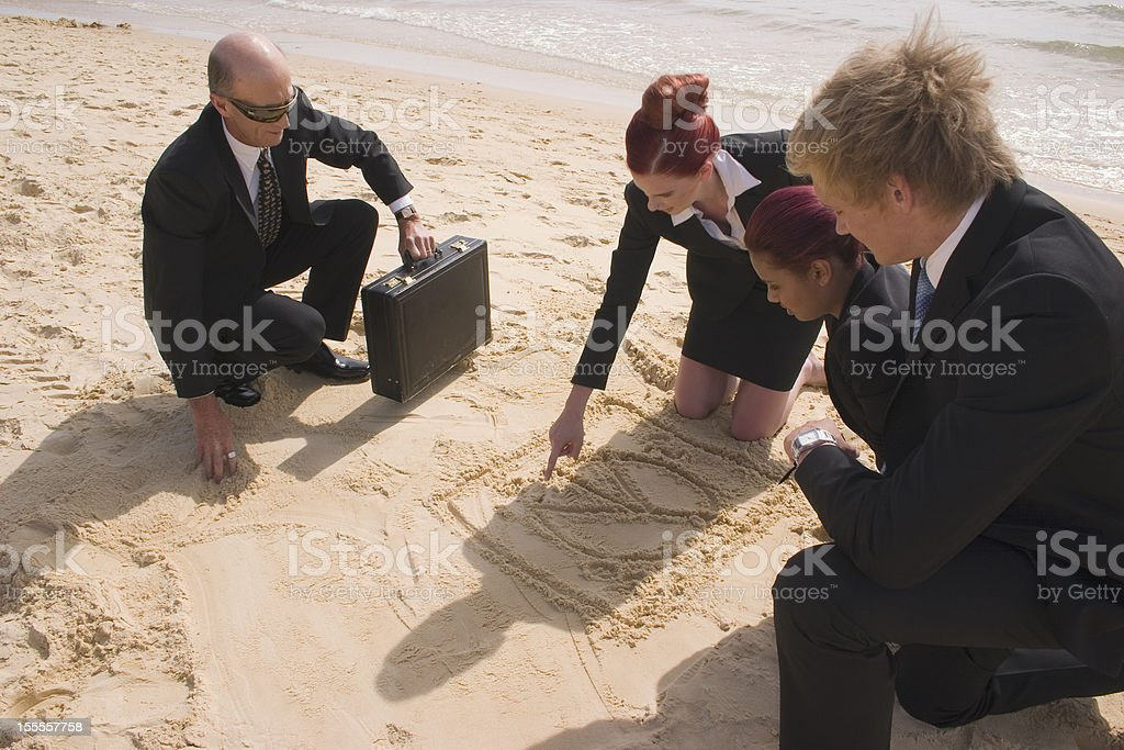 Businesswoman Drawing Pie-chart with Team stock photo