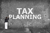 istock businesswoman drawing tax planning on the wall 527877397