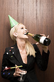 Businesswoman drinking champagne