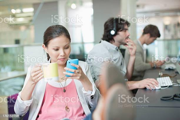 Businesswoman drinking coffee and text messaging with feet up in picture id170153158?b=1&k=6&m=170153158&s=612x612&h=xbyysj6eb9pdu4rsv5sptv gawnesdvplcmskttdj8w=