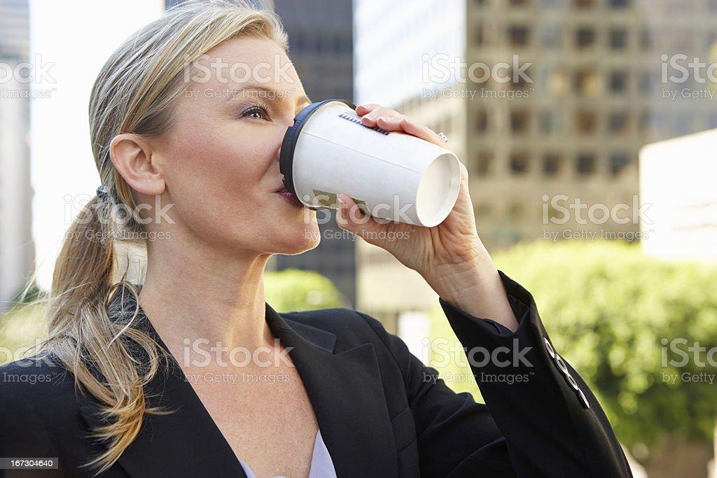 Businesswoman Drinking Takeaway Coffee Outside Office royalty-free stock photo