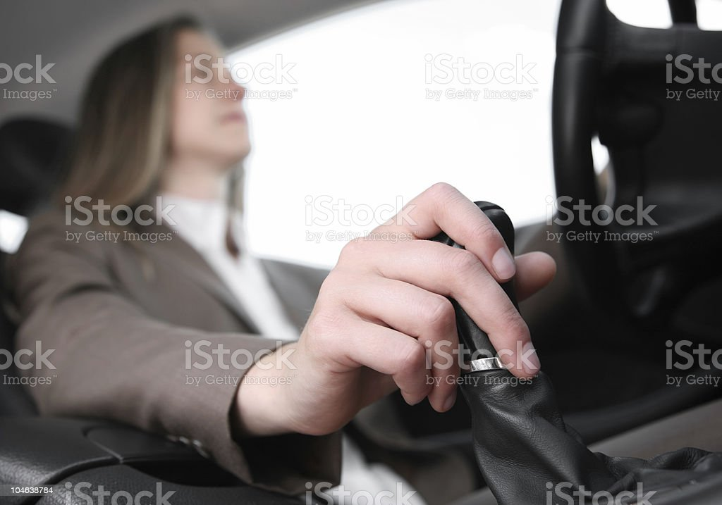 businesswoman driving a car royalty-free stock photo
