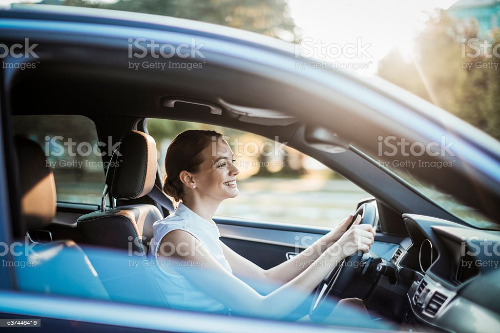 Businesswoman driving a car stock photo