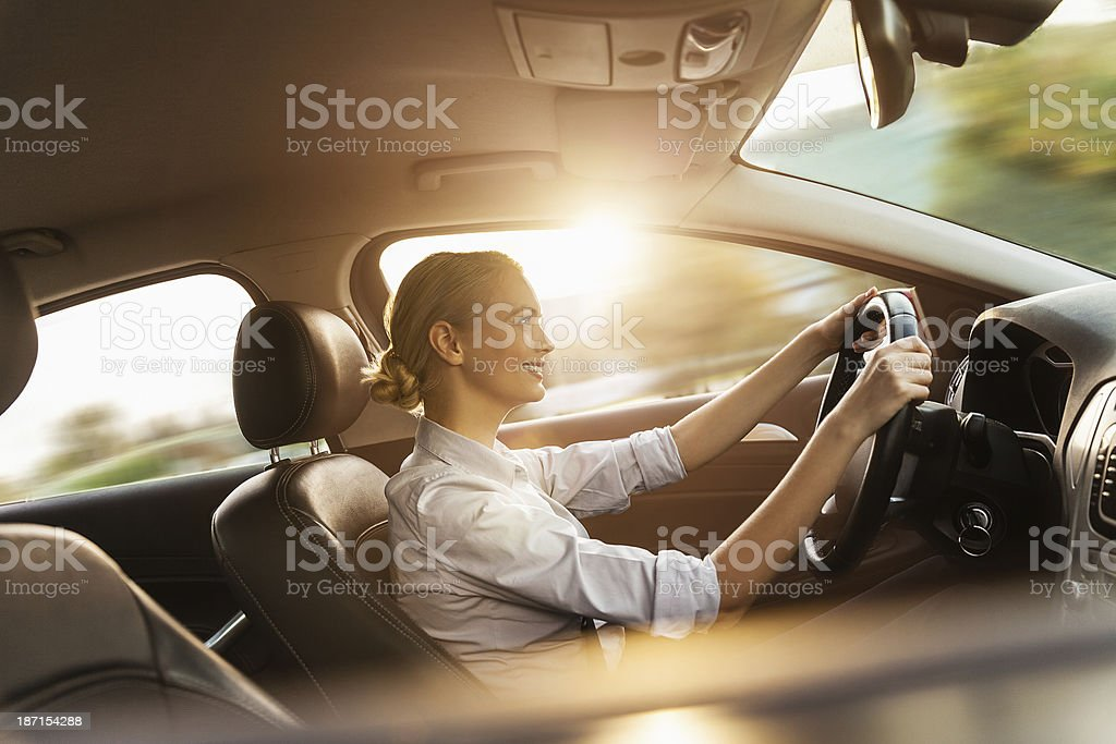 Businesswoman driving car stock photo