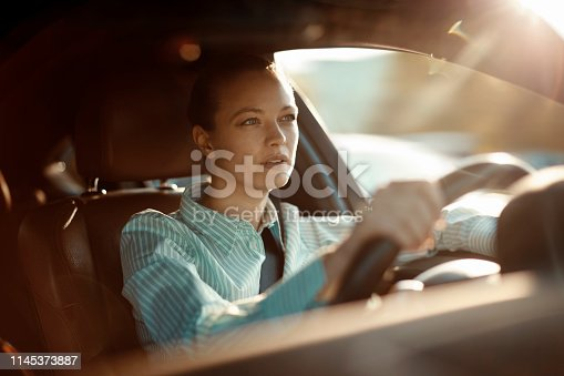 Close up of a businesswoman driving a car