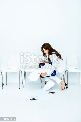 Businesswoman having an accident in a waiting room: bad luck day.