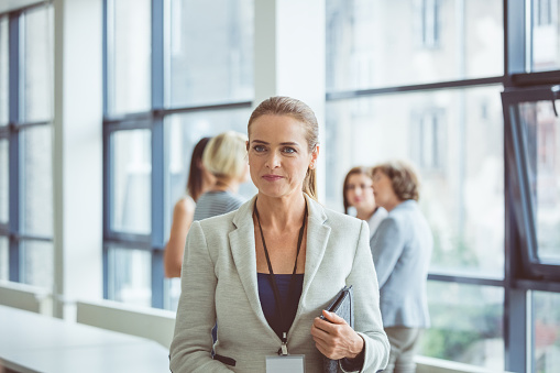 Businesswoman During Break In Seminar Stock Photo - Download Image Now