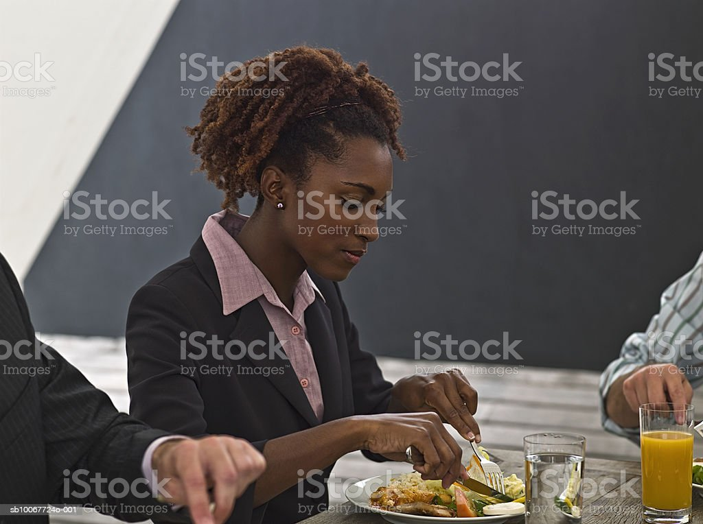 Businesswoman eating lunch royalty-free stock photo