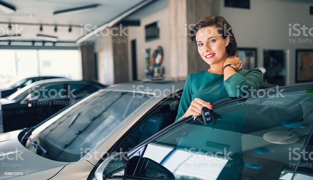 Businesswoman enjoying a new car stock photo