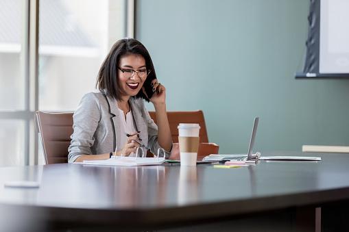 Businesswoman enjoys phone conversation