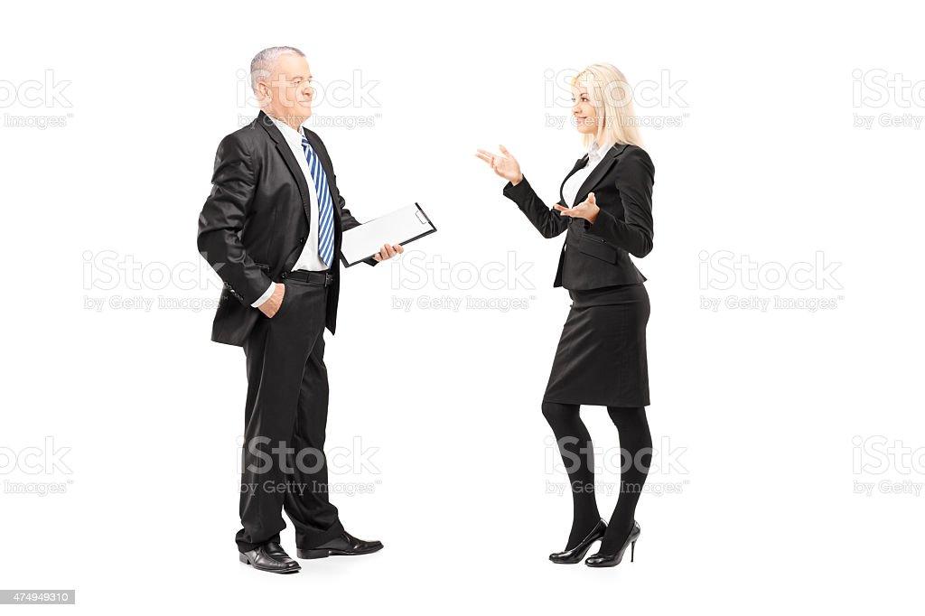 Businesswoman explaining an idea to her boss stock photo