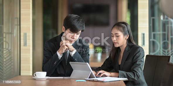 1068752548istockphoto Businesswoman explaining her idea concepts to her male coworker 1169852003