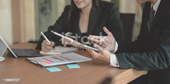 1068752548istockphoto Businesswoman explaining her idea concepts to her male coworker 1169852027