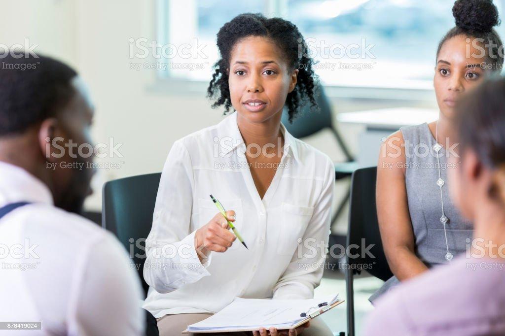 Businesswoman facilitates meeting stock photo