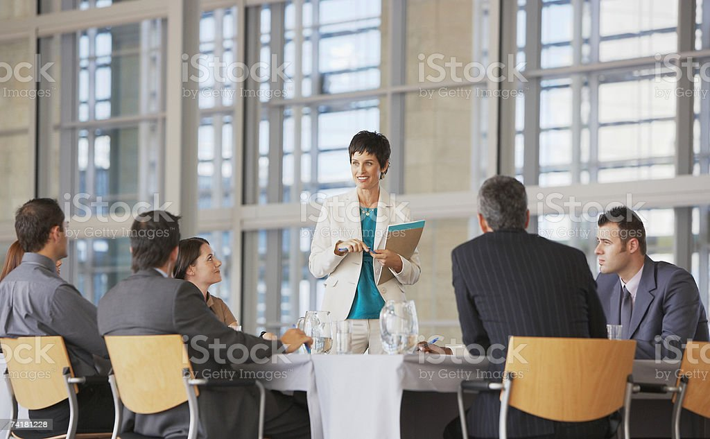 Businesswoman facilitating group meeting royalty-free stock photo