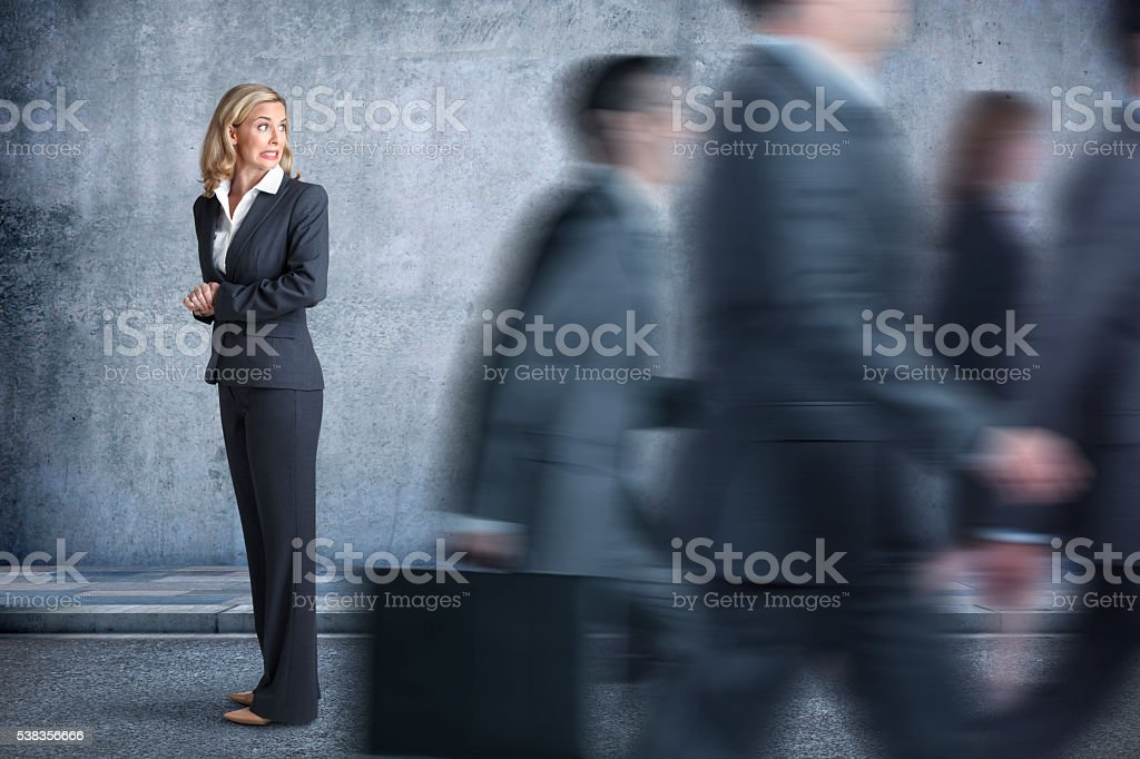 Businesswoman Feeling She Is Being Left Behind stock photo