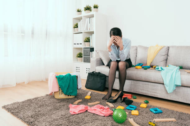 businesswoman feels frustration to see the mess stock photo