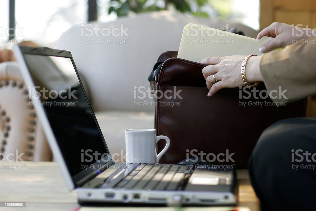 Businesswoman, Files, Briefcase, Laptop royalty-free stock photo