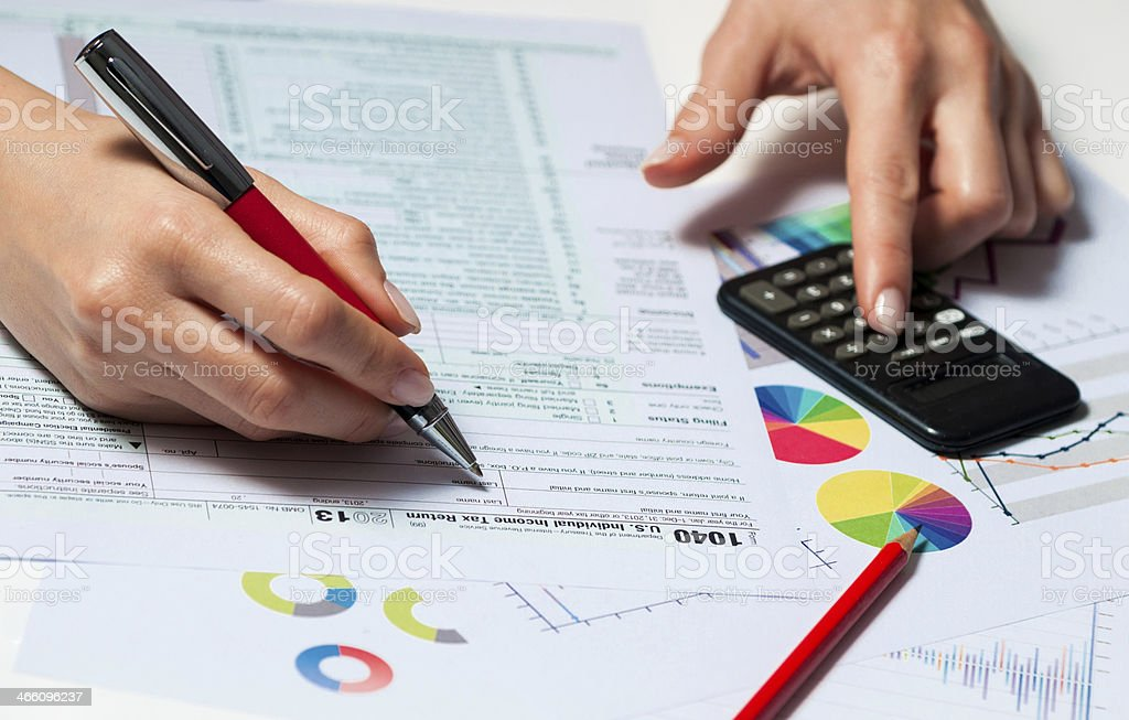 Businesswoman filling IRS document -1040 tax form, finance and budget stock photo
