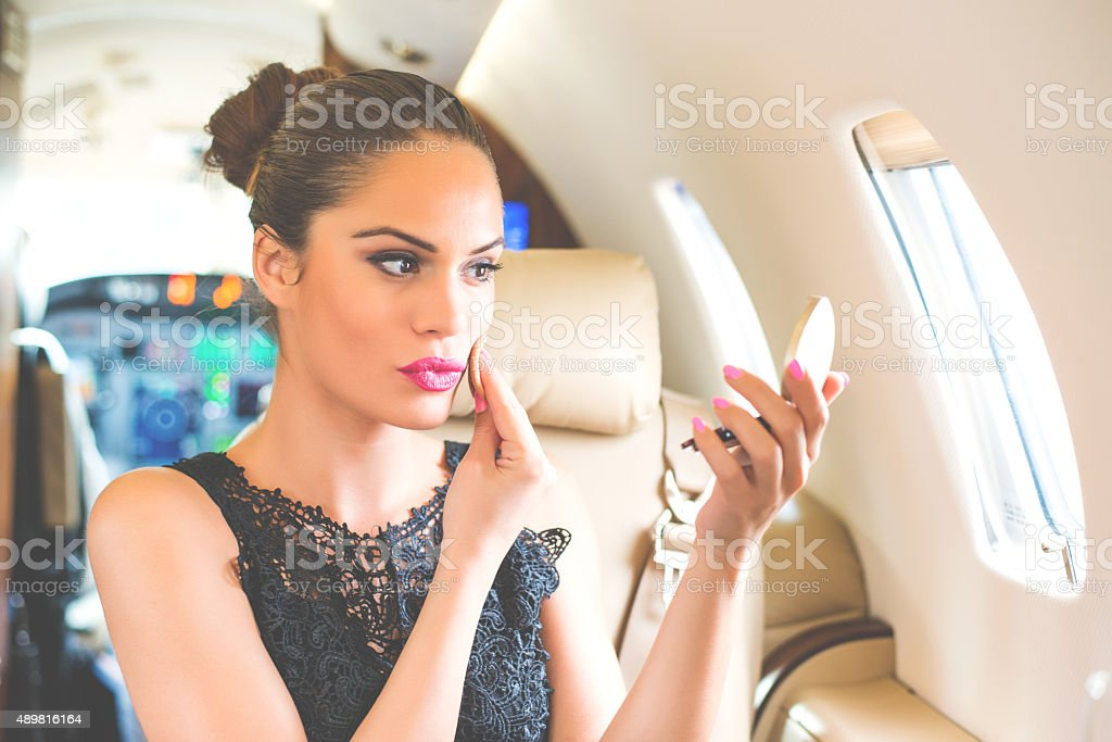 Businesswoman fixing make up stock photo