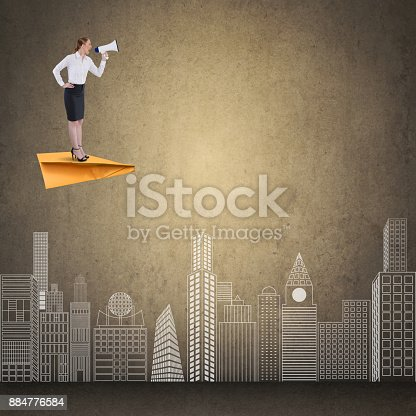 903659714istockphoto Businesswoman flying on paper airplane and speaking on megaphone 884776584