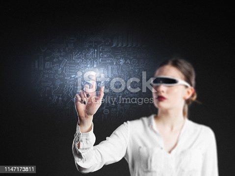 693586040istockphoto Businesswoman futuristic touch idea plan 1147173811