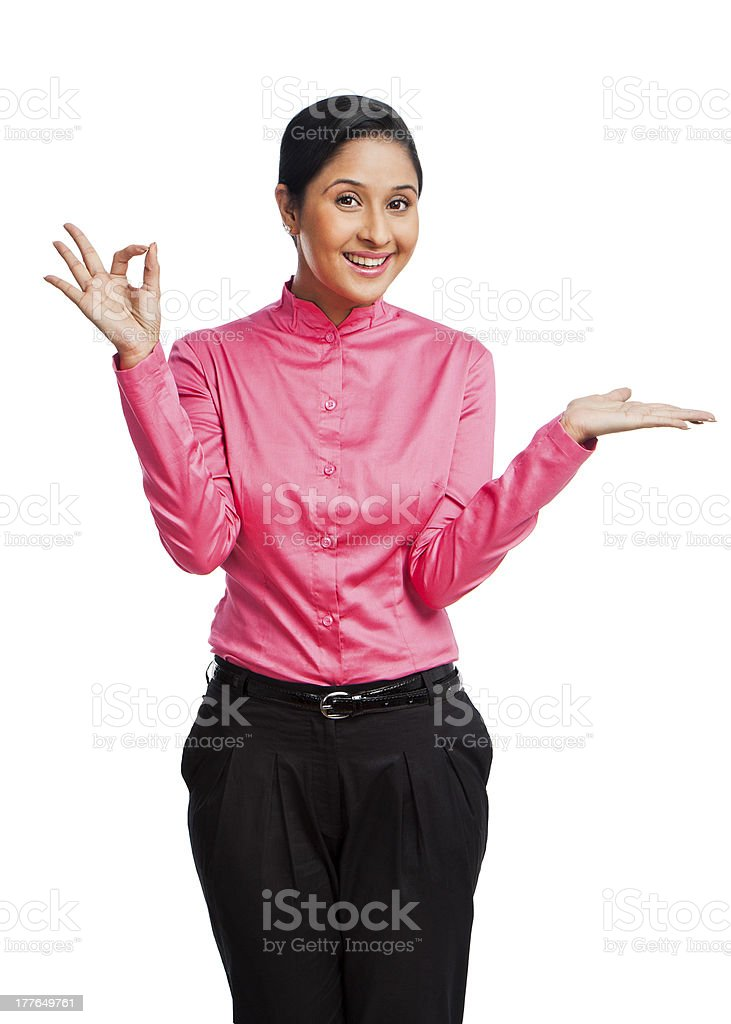 Businesswoman gesturing and smiling royalty-free stock photo