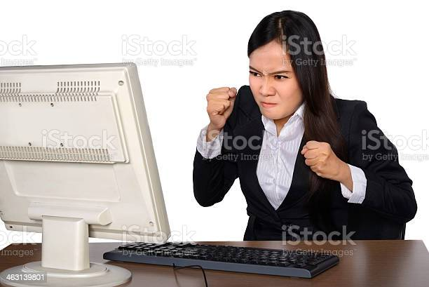 Businesswoman Getting Crazy In Front Of Her Laptop Stock Photo - Download Image Now