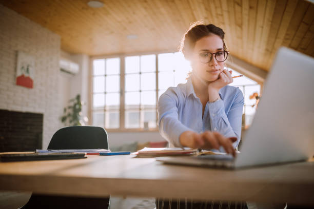 Businesswoman Getting Her Work Done at Office stock photo