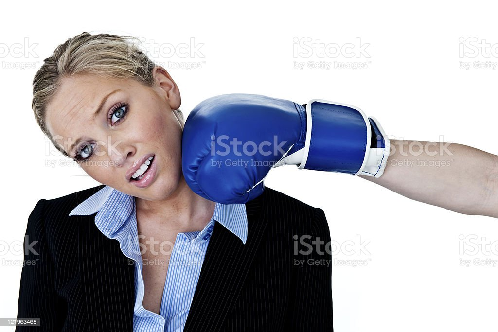 Businesswoman getting hit royalty-free stock photo