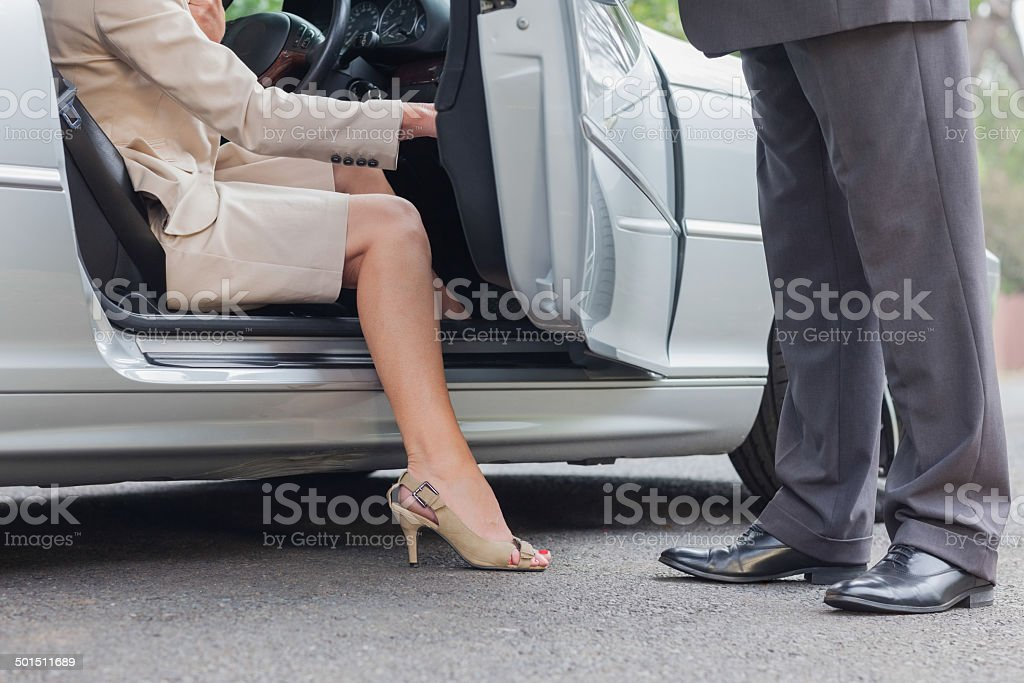 Businesswoman getting off classy cabriolet stock photo
