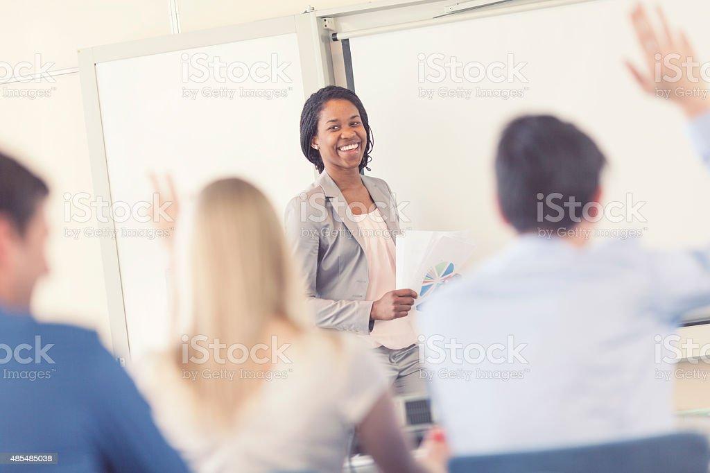 Businesswoman giving a presentation stock photo