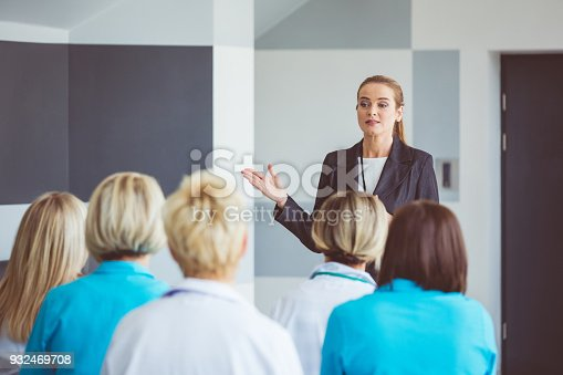 933450738 istock photo Businesswoman giving a speech on seminar for medical staff 932469708