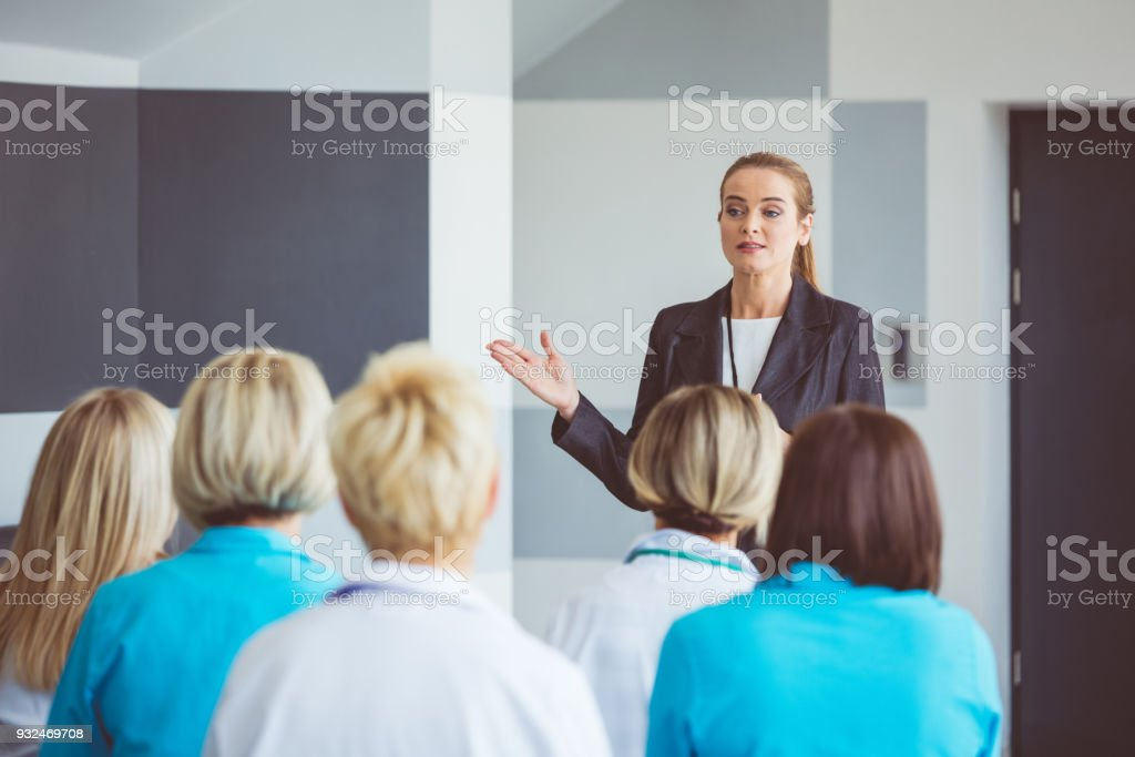 Businesswoman giving a speech on seminar for medical staff stock photo