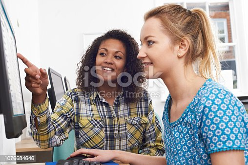 Businesswoman Giving Computer Training In Office
