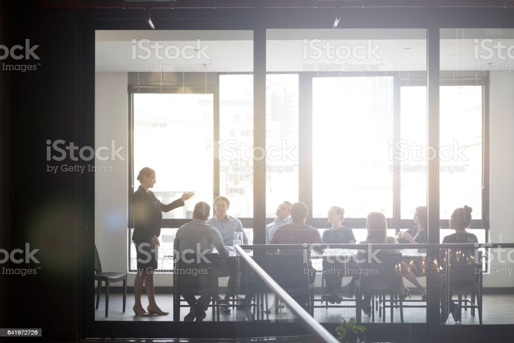 Businesswoman giving presentation in office stock photo