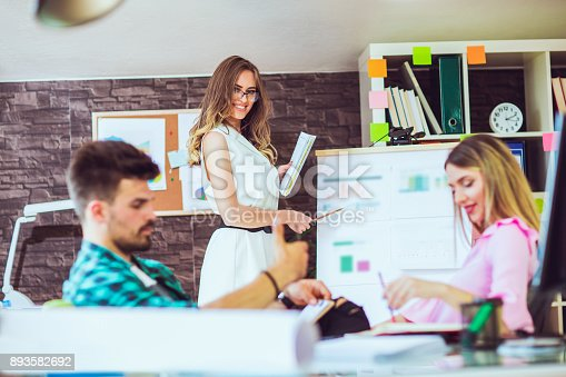 576902490 istock photo Businesswoman giving presentation on future plans to colleagues 893582692