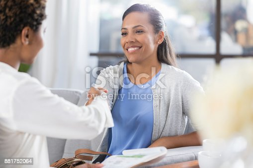 istock Businesswoman greets client before meeting 881752064