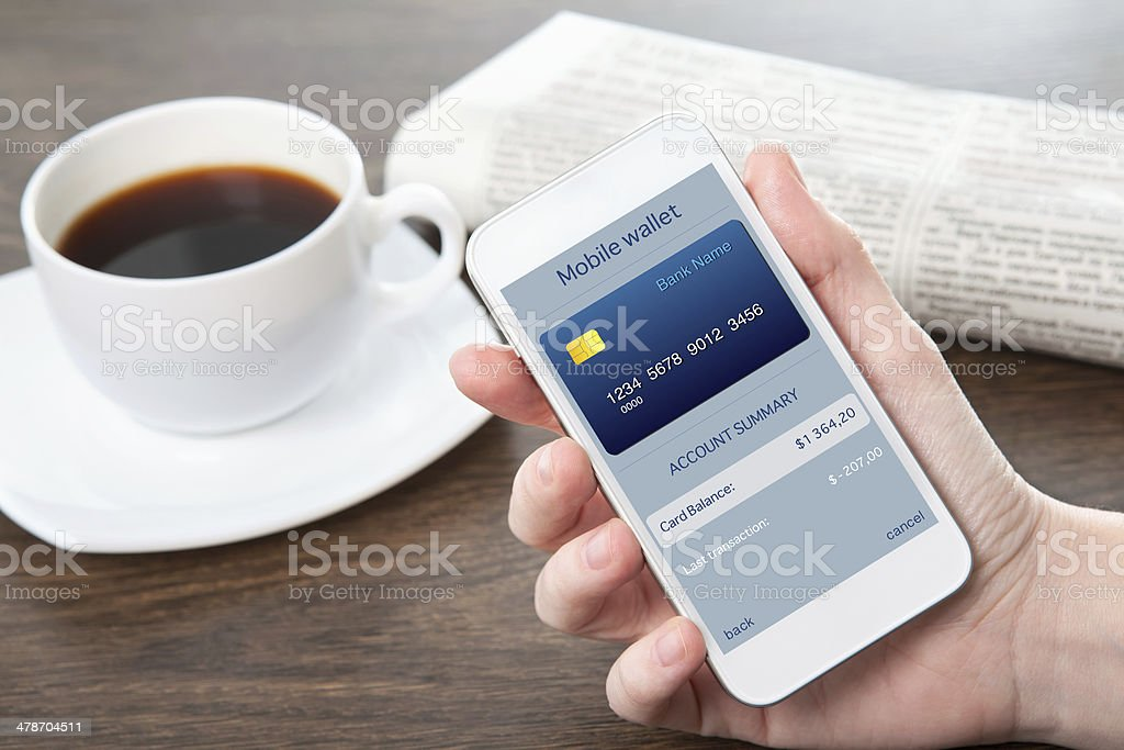 businesswoman hand holding a phone with mobile wallet online shopping stock photo