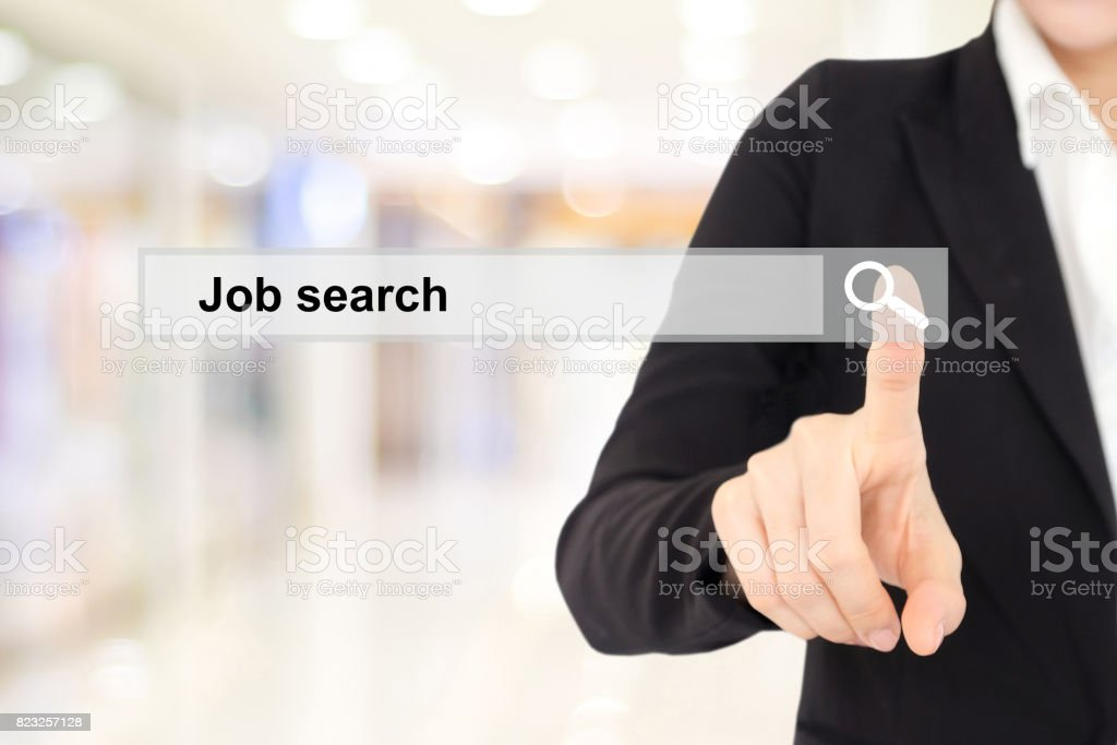 Businesswoman hand touching job search on search bar over blur background stock photo