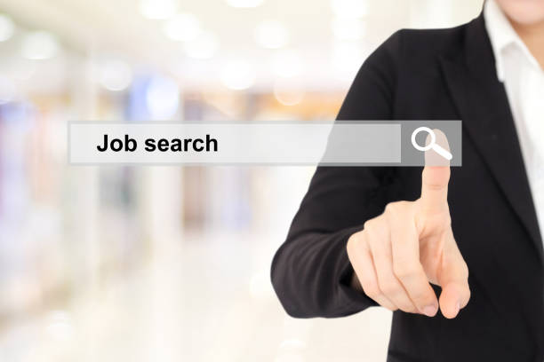 businesswoman hand touching job search on search bar over blur background - job search stock photos and pictures