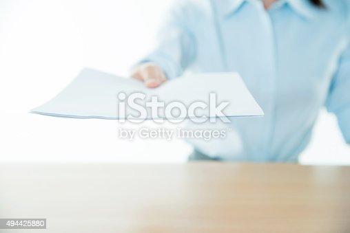 istock Businesswoman handing an agreement paper 494425880
