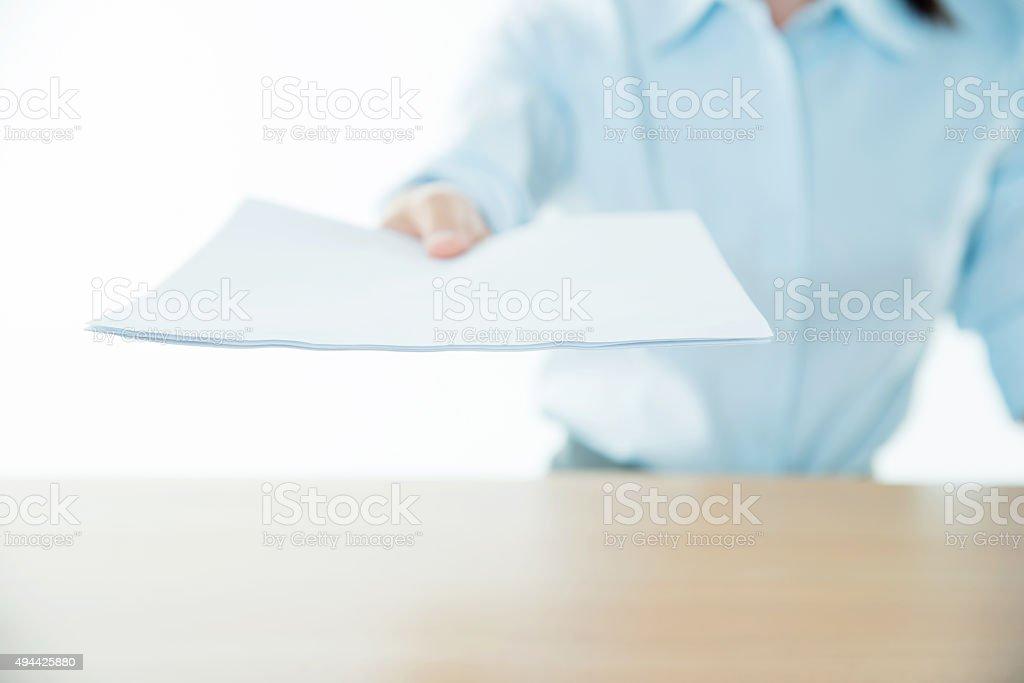 Businesswoman handing an agreement paper stock photo