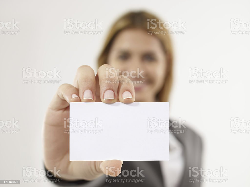Businesswoman Handing Business Card royalty-free stock photo